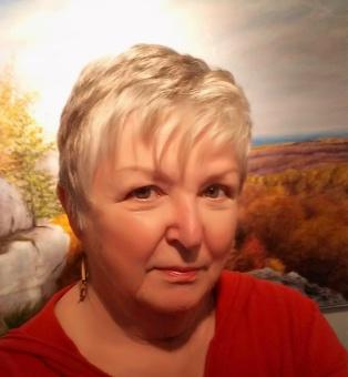 Picture of Elizabeth with her painting Rhythm of the Rocks